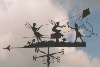 Fairies flying kites weather vane