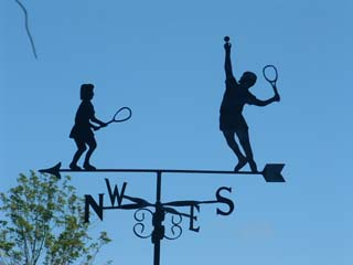 Two tennis players weathervane