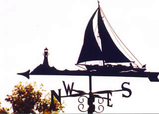 Yacht with Lighthouse weathervane