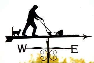 Man mowing with cat weathervane